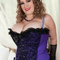 Obese solo model Smiley Emma exposes her humungous boobs in mesh tights and forearm socks