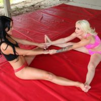 Fit girlfriends Stevie and Shae facesitting latex cut-offs outfitted boy in bare feet