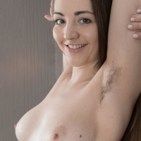 Supple amateur model Cherry Bloom shows her fur covered pits and furry pussy in the nude