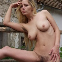 Girl next door type rides her pony in the naked before showing furry cunt in area