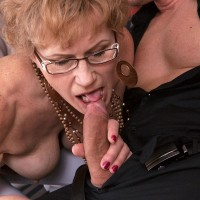 Grandmother in glasses tempts a younger stud and deep throats his dick on couch