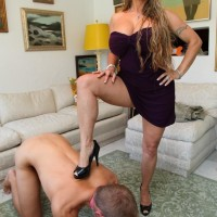 High heel clad Dominatrix Holly Halston having collared sissy slurp out slit