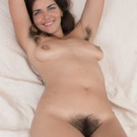 Hirsute dark haired Katie Z strips off her body-suit to make her au naturel modeling debut outdoors