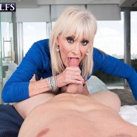 Horny 60 plus MILF Leah L'Amour entices a younger boy in the sauna before providing a BJ