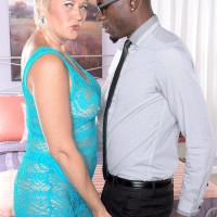 Dirty grandma Tracy Eats displays her bare knockers to a black dude in a unveiling sundress