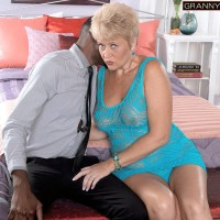 Insatiable grandmother Tracy Eats seduces a younger black dude by flashing her humungous natural titties