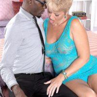 Nasty grandma Tracy Slurps seduces a younger black guy in a see-thru dress