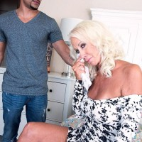 Alluring 60 plus MILF Madison Milstar entices a junior ebony boy in a taut fitting dress