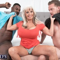 Enticing 60 plus MILF Sally D'Angelo deep-throats on a BBC and a large white hard-on simultaneously