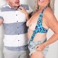 Phat sixty plus MILF Silva Foxx tempts a junior man by flashing her titties in a denim mini-skirt