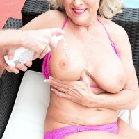 Gorgeous Sixty plus woman Katia has her big boobies groped by younger boy on patio