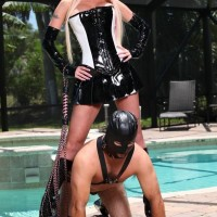 sexy ash-blonde Dominatrix Alexia Jordon straddles a hooded male slave in spandex by the pool