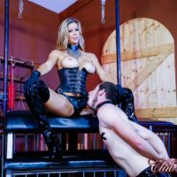 Tempting ash-blonde Dominatrix Alexis Fawx mouth plows a sissy with a strapon penis in a basement