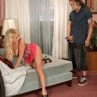 Hot ash-blonde granny with excellent legs Natasha entices a blows a younger ebony guy
