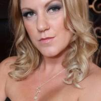 Seductive light-haired girlfriend Ashley Edmunds makes her slave husband suck her strap-on rod