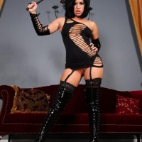 Sexy dark haired Belle Noir slaps her uber-sexy ass with a whip in a revealing ebony dress