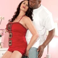Mind-blowing brown-haired grandmother Rita Daniels entices a younger ebony dude with her superb legs