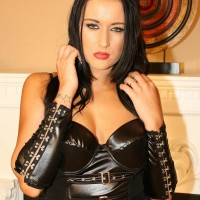 Sweet dark haired Domme Ashley plays with her nips in leather and nylons