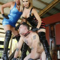 Mind-blowing mistresses Cherry Morgan and Kylie Rogue use a male sub as bench to sit upon