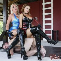 Killer mistresses Cherry Morgan and Kylie Rogue use a masculine submissive as bench to sit upon