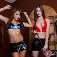 Sexy gals Dava and Molly model fetish wear amid RESTRAIN BONDAGE & DISCIPLINE gear while in a basement