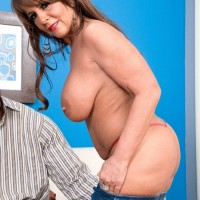 Seductive grannie Cassidy has her gigantic titties fondled while a black stud unclothes her