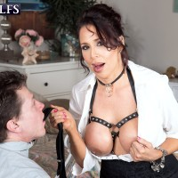 Marvelous grandma Lisa Marie Heart entices a younger man in a choker and restrict bondage harness