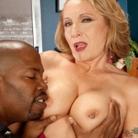fantastic grannie Luna Azul tempts a younger black boy in satin lingerie and denim jeans on a bed