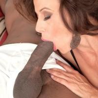 Tempting grandma Mimi Moore gargles on a large black penis while wearing in seductive lingerie