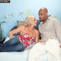 Cool grandmother Payton Hall is undressed to a pink thong by her junior black lover