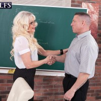 Gorgeous mature professor Woman S seduces a masculine student in a black micro-skirt and glasses