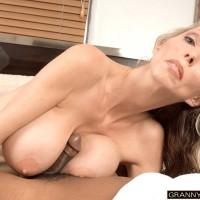 Sumptuous aged woman Ophelia Vixxxen fellates and fucks a immense ebony dick
