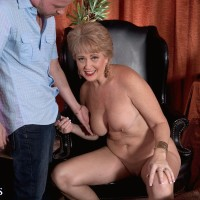 Enticing older broad Tracy Slurp is freed from a cock-squeezing sundress before having her swell nipples fellated