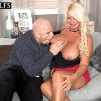 Beguiling senior doll Annellise Croft has her monster-sized hooters fellated on before a tit have sex