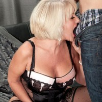 Gorgeous mature doll Desire Collins seducing younger man with gigantic knob in lingerie