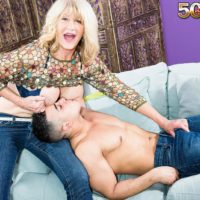 Marvelous experienced dame Kendall Rex letting humungous hooters loose while seducing junior guy