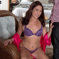 Enticing experienced doll Renee Black strips off her lingerie for a black dude