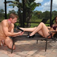 Gorgeous mistress Callie Calypso makes her sub husband worship her feet by a pool