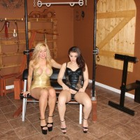 Kimber Woods and a uber-sexy gf piss into a cup restrained by a collared male slave