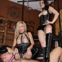 Kimber Forest and another woman in fetish wear trample a naked stud in ebony boots