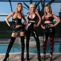 Latex garbed Dominas Alexia, Tyler and Alina strut before abusing male sex submissive