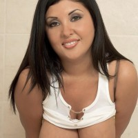 Latina MILF Daylene Rio looses her giant melons from wet t-shirt and brassiere