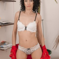 Long-legged first timer Cleo Fantasy demonstrates her natural honeypot after discarding hooter-slings and panty set