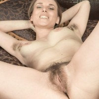 Long-legged amateur Donatella doffs stilettos to flash her furry armpits and thicket in the naked