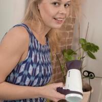 Leggy yellow-haired European solo girl Darina Nikitina opening up hairy honeypot in socks