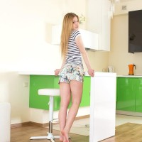 Spindly golden-haired teenager Markiza unsheathes her teenie tits while garmented sheer undies