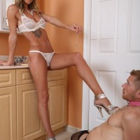 Tall blonde mistress Alexia Jordon has her submissive man tongue her from behind
