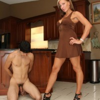 Lanky blond mistress Christine humiliating collared subby spouse in high heeled shoes