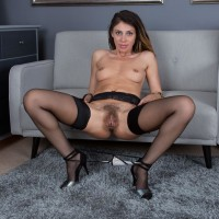 Long legged black-haired first-timer Chloe R opening up furry gash after hose removal