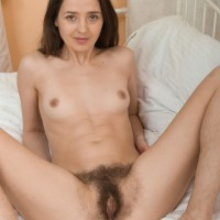 Lumbering dark haired first-timer Lisa Carry slipping panties over butt to unveil unshaven vag
